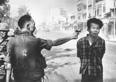 South Vietnam national police chief Nguyen Ngoc Loan executes a suspected Viet Cong member. (Eddie Adams)