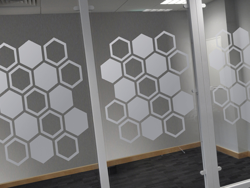 P65-W silver crystal etch effect film in a stylish hexagonal pattern applied onto interior office parition windows.