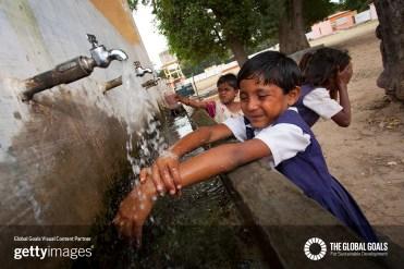 Indian schoolchildren washing at village school