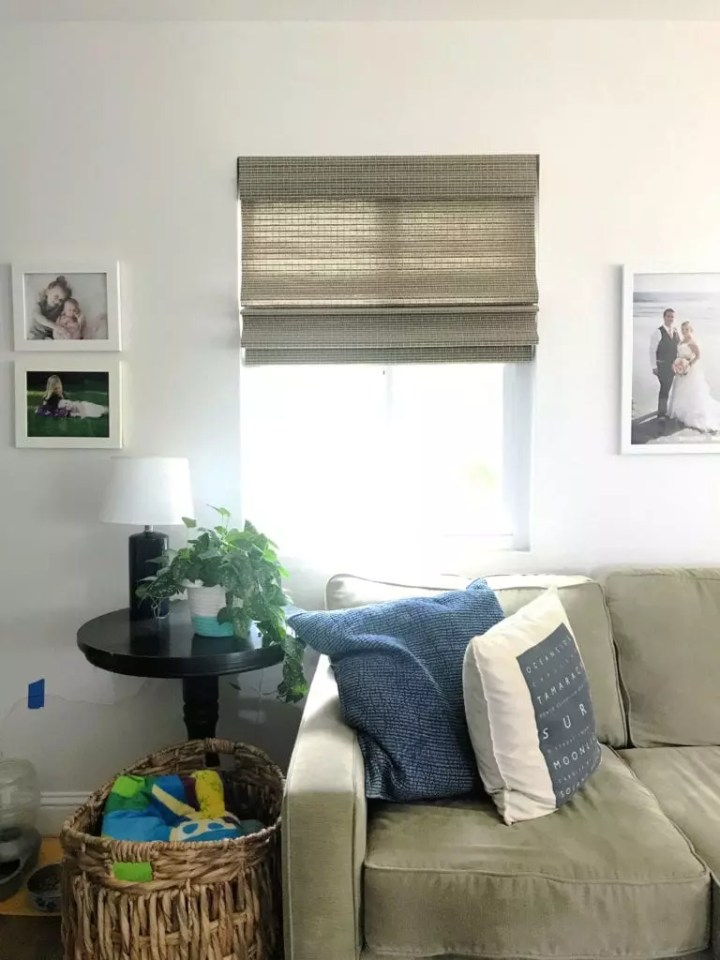 How to install roman shades in 5 easy steps. These affordable window coverings are cordless and an easy DIY update to any space. We added our roman shades to our living room and kitchen for a completely updated look. #romanshades #DIY #howto