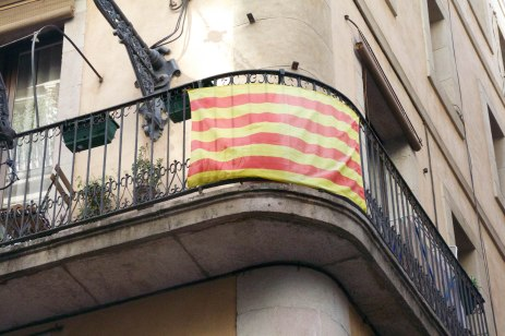 A Senyera flag hangs off a balcony in the Gothic Quarter in Barcelona.