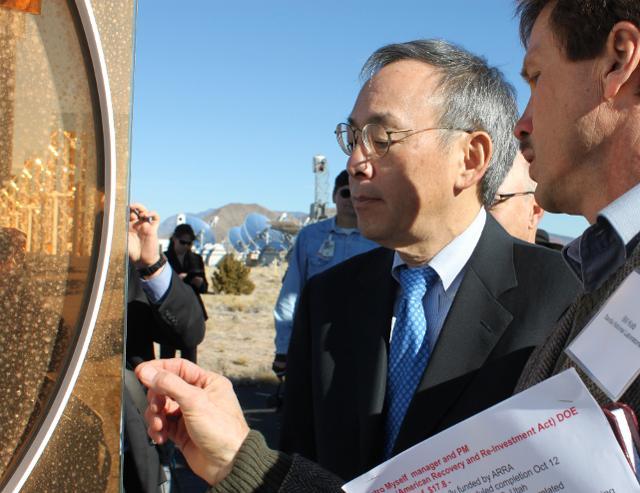 Energy Secretary Steven Chu, left, examines coatings at Sandia National Laboratories in Albuquerque, N.M., on Thursday, Jan. 26, 2012.