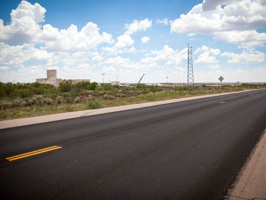 A 13 mile strip of the WIPP north access road was resurfaced as a part of the settlement