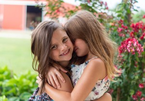 Two girls embracing while smiling