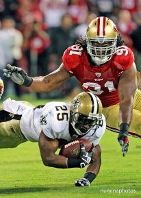 20 September 2010: 49er Will Smith tackles Saint Reggie Bush during the New Orleans Saints' 25-22 win over the San Francisco 49ers at Candlestick Park in California.