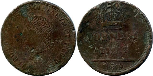 Esemplare falso di un 10 tornesi 1819: D/ FERD. I. D. G. REGNI SICILIARUM ET HIER. REX, testa coronata del re verso sinistra , il simbolo sotto il collo non è visibile; R/ TORNESI DIECI, sopra corona, in esergo 1819. Peso 26,75 g, diametro 38 mm. Contorno ''leggermente martellato''.