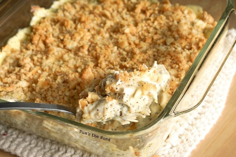 Poppy Seed Chicken Casserole - spoon sticking out of baked casserole