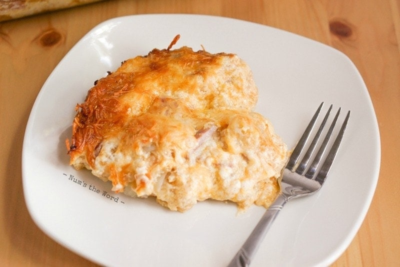Ham & Hash Brown Breakfast Casserole - dished up on a plate with fork