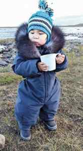 photo courtesy of Cassie Noah<br /> Rankin Inlet<br /> My son Jaden Noah having a cup of tea a couple years ago at Diane River in Rankin.