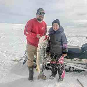 "photo courtesy of Dianna Joy Kaludjak<br /> Rankin Inlet<br /> Sophia Kaludjak, age 10, with her dad, Leo Kaludjak, at Peter Lake holding her big trout measuring 43-1/8"", that she pulled out herself."