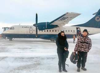 Arviat Film Society members Elena Akammak, left, and Jamie Okatsiak are happy the weather held steady just long enough for them to depart for the Nunavut film conference on March 12-13 in Iqaluit. Photo courtesy Eric Anoee