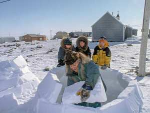 0804Dino Bruce.jpg Dino Bruce Coral Harbour My late Grandfather, Mikitok Bruce, teaching his great grandchildren, Devin Bruce, Austin Bruce and Chad Bruce, how to build an igloo, taken several years ago.