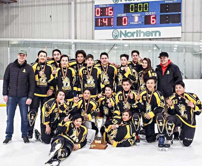 The 2019 Toonyk Tyme minor hockey bantam champion Rankin Rock are, back row from left, David Clark (coach), Alexander Angalik, Garren Voisey, Malla Ittinuar, Kobe Tanuyak, Owen Connelly-Clark, Brady Tucktoo, Gregory Wiseman, Simon Wiseman, Charlotte Siksik and Graham (Bubsy) Kusugak (assistant coach), and middle row from left, Kadin Eetuk, koby Connelly, Terence Pilakapsi, Justin Towtongie, Maximus Ammaq and Thayer Komakjuak and front from left, Sandy Tattuinee and Tucker St. John at Iqaluit on April 21, 2019. Photo courtesy Rankin Rock