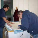 Lucero family members prepare the marble for sealing.