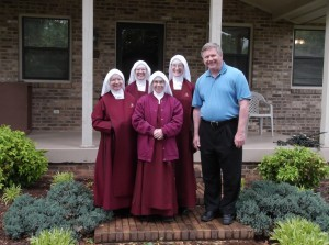 Bishop Richard F. Stika welcomes the Handmaids.