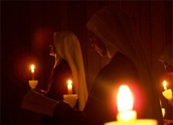 Handmaids listen to the singing of the Exultet on Holy Saturday.