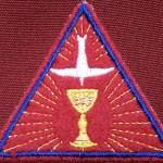 Trinitarian emblem worn over the heart.