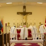 Three priests concelebrated with Bishop Stika.