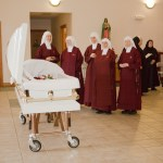 Handmaids at Mother's casket.