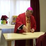 Bishop Stika pours the chrism.