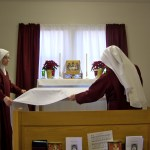 The Sisters prepare the altar.