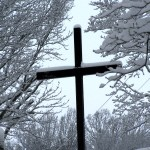 Snow covered cross.