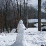 A snow nun melting in the sun.