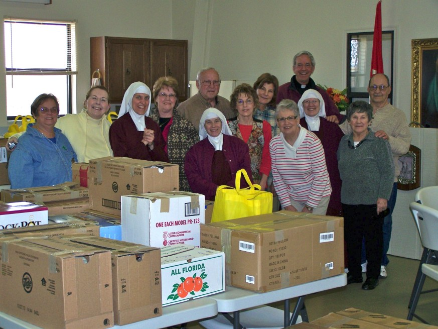 Father John Dowling and the CCW convoyed to Benton with the generous outpouring of gifts from the parish.