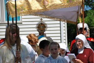 The Blessed Sacrament is carried in procession during Corpus Christi in Illinois.