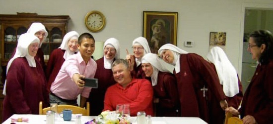 Alvin takes a Selfie of the Bishop with his Handmaids