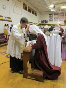 Father Hendershott blessing Sister.
