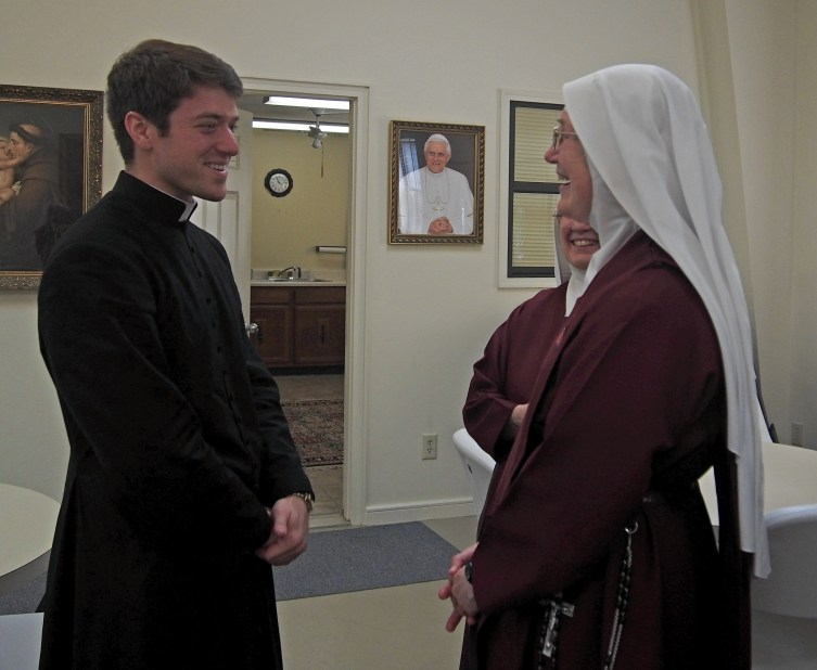 Father Hendershott greets Mother Marietta after the Mass at Christ, Prince of Peace Retreat Center in Benton.