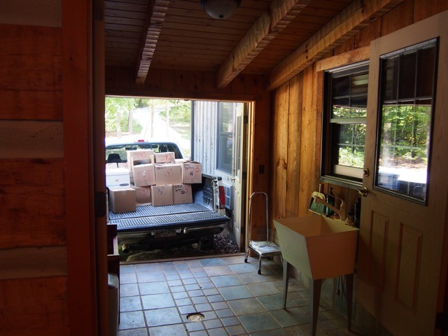 First truckload from the storage shed arrives with boxes marked by location.