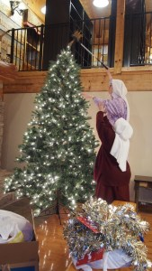 How many nuns, ladders, step stools, and grabbers does it take to put the star on a tree