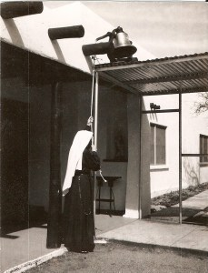 "From the archives: Handmaid ringing ""Old Faithful"" calling the Sisters to prayer"