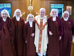 Our Handmaids with Father Deitz after his anniversary Mass.