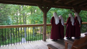 The Handmaids already resident in East Tennessee show their newly come Sisters the sunset view off the deck towards Blessed Sacrament Cemetery.