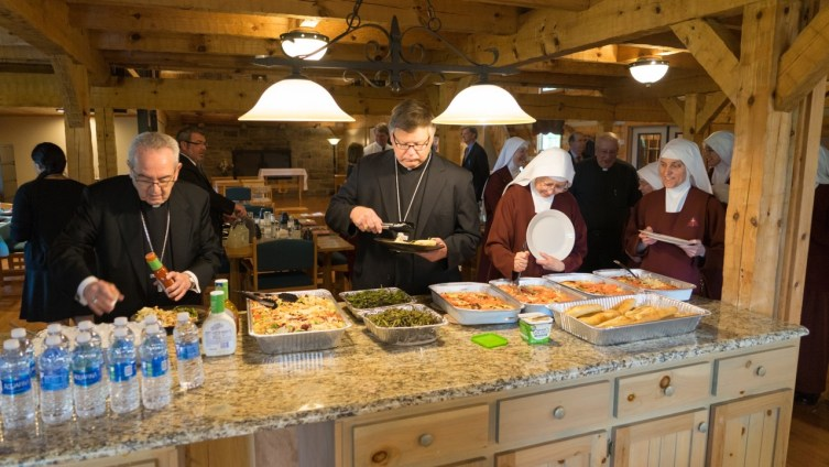 Valerie Dee cooked the entire meal for Sisters and distinguished guests. Here Cardinal Rigali and Bishop Stika sample the delicious menu.