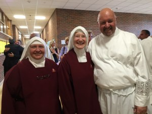 Prior to the Mass, Diaconate Candidate Scott Maentz joins the Handmaids for a photo.
