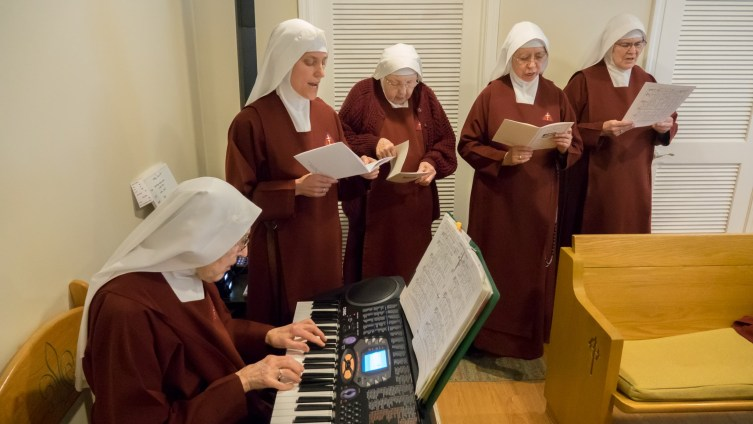 Singing the Litany of the Saints prior to Sister's renewal of vows