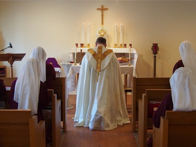 Bishop Stika in Adoration before Benediction