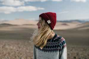 young woman standing in desert