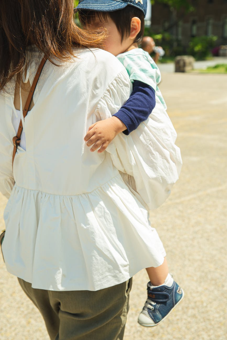 mother carrying little child on hands