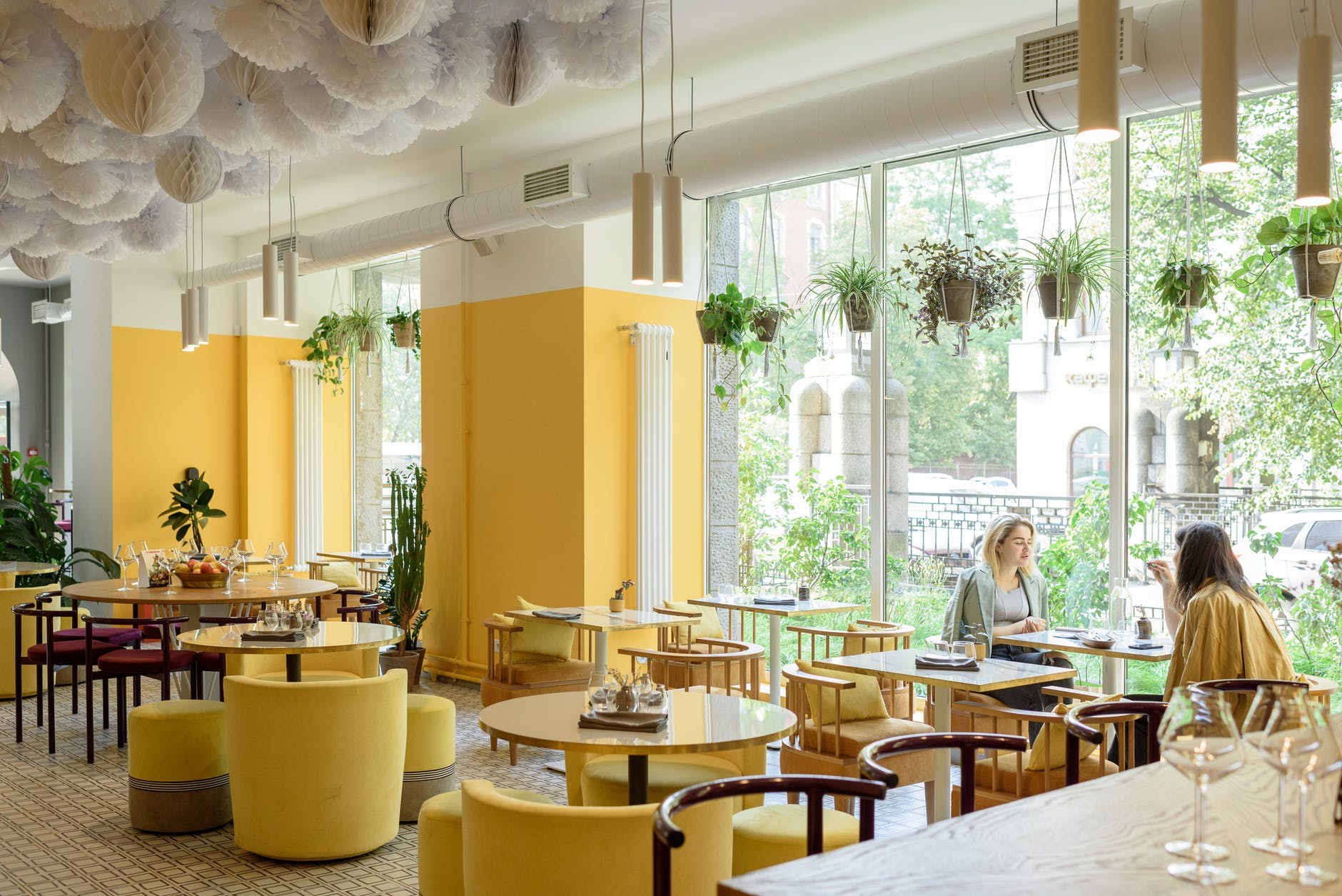 women in modern cafe with stylish bright interior