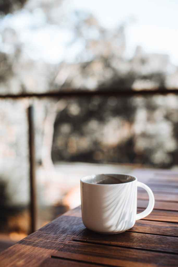 mug of coffee on wooden table