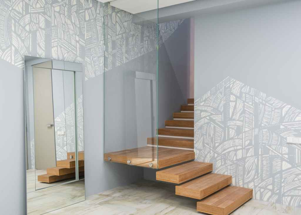 staircase with glass wall in modern apartment