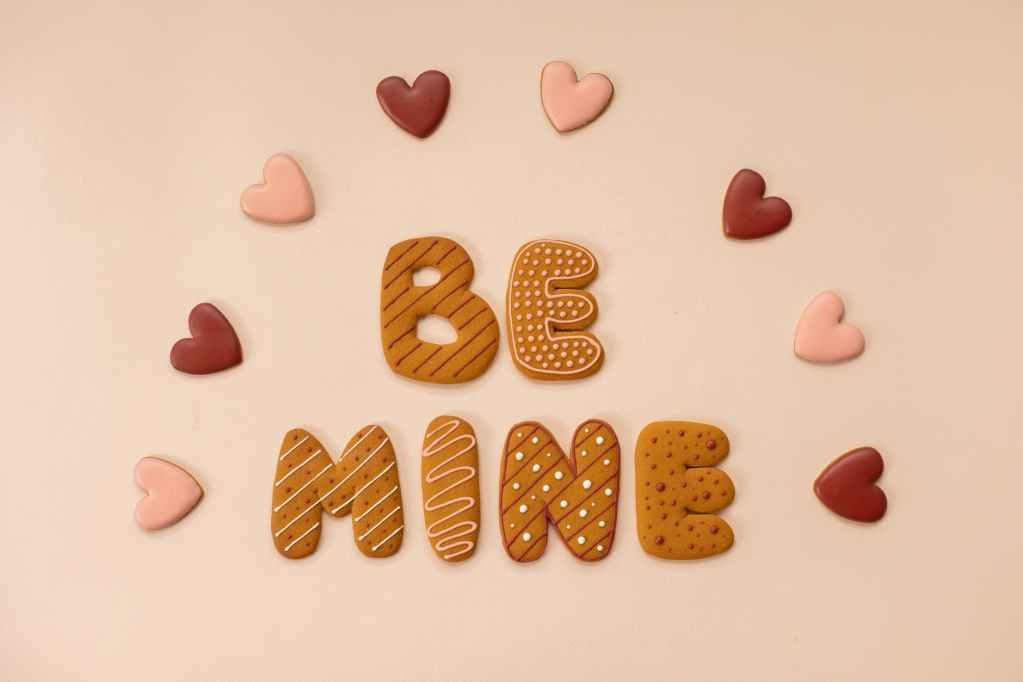 arrangement of letter cookies on surface