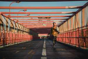fast man running on bridge