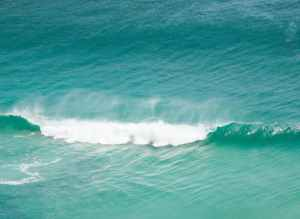 turquoise sea water surface with waves