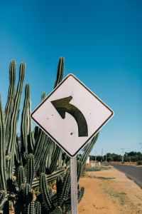 roadway sign in desert land